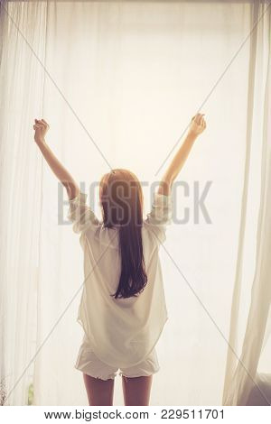 Beautiful Young Asian Woman Stretch And Relax In Bed After Wake Up Morning At Bedroom, Back View, Ne