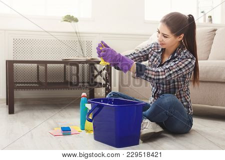 Smiling Woman Polishing Wooden Floor. Young Girl In Protective Gloves Washing Rag In Bucket, Spring