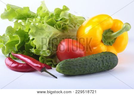 Assorted Vegetables, Fresh Bell Pepper, Tomato, Chilli Pepper, Cucumber And Lettuce Isolated On Whit