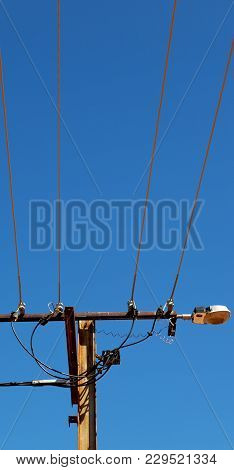 Power Line With Electrical Pole In The Clear Sky