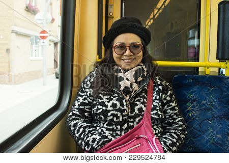 Thai Old Women People Sitting On Tramway From Sandhausen District Go To Heidelberg, Germany