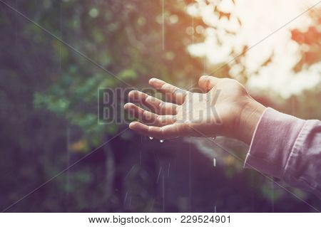 The Hand Touch Dropping Rain Scattered Down. Environmental Concept.