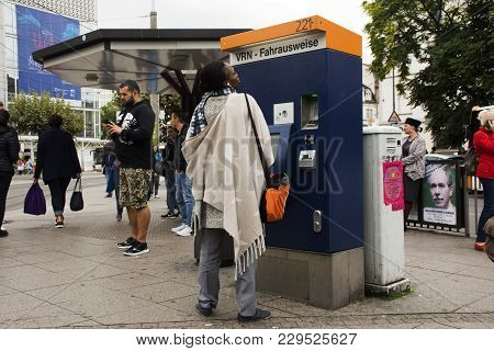 African-german Woman Buy Ticket Of Tranway From Automatic Sale Ticket Box At Heidelberg Altstadt Or