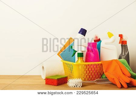 Bucket With Cleaning Items On Wood Table, Closeup. Bucket, Brush, Rubber Gloves, Sponge, Disinfectio