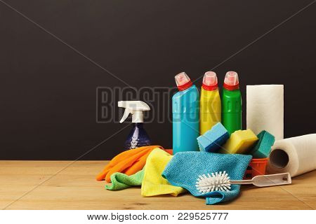 Colorful Group Of Cleaning Supplies For Environmentally Friendly Tidying Up. Bottles In Bucket, Rags