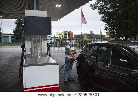 German Old Men People Drive Car Go To Fill Oil In Petrol Station At Sandhausen Distric In Heidelberg
