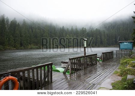 Motion of water of Mummelsee lake while raining in Black Forest or Schwarzwald at Baden-wurttemberg