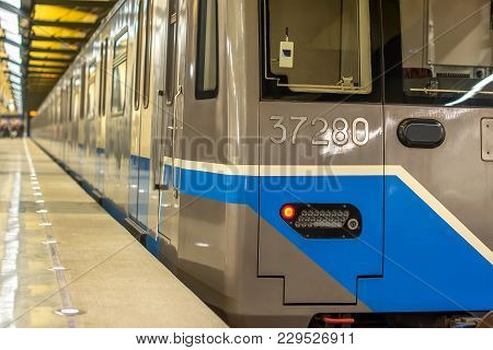 Train Subway Underground With Glowing Red Rear Position Lights Luminous Headlights Stands At The Sta