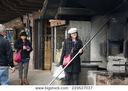 Asian Thai Woman Travel Shopping And Posing With Firewood Stove Old Style At Black Forest At Baden-w