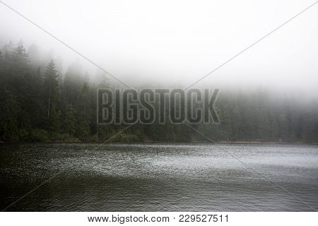 Motion Of Water Of Mummelsee Lake While Raining In Black Forest Or Schwarzwald In Germany