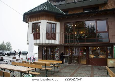 German And Travelers People Visit And Use Service In Classic Restaurant And Souvenir Shop Building A