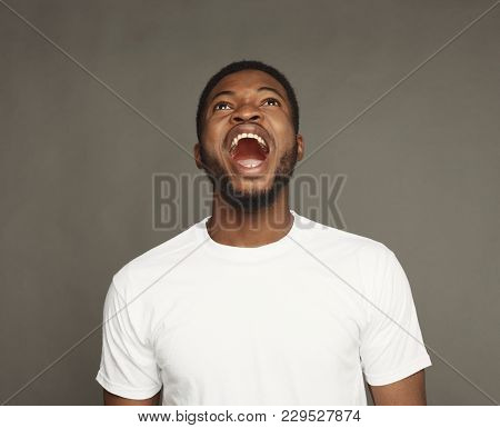 Black Man Cry Out In Despair And Shock. Expressing Strong Emotions, Anger, On White Background, Stud