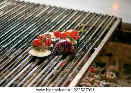 Grilled Vegetables On Iron Grill. Cherry Tomato, Eggplant, Onion And Rosemary On Grill. Grilling And