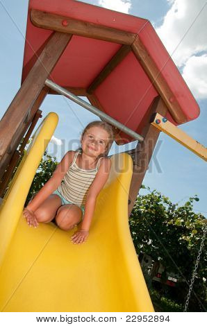 Happy playing - little girl on the playground