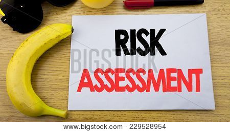 Risk Assessment. Business Concept For Safety Danger Analyze Written On Note Empty Paper, Wooden Back