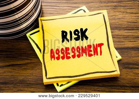 Handwriting Announcement Text Showing Risk Assessment. Business Concept For Safety Danger Analyze Wr