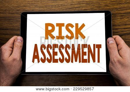 Hand Writing Text Caption Risk Assessment. Business Concept For Safety Danger Analyze Written Tablet