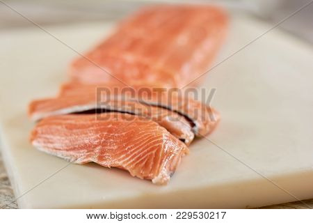 Sliced Raw Salmon On Cutting Board. Fresh Salmon Fillet On Cutting Board. Restaurant Of Seafood.