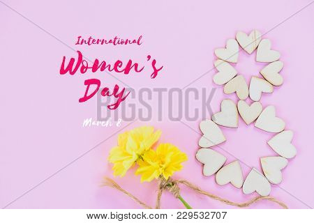 Happy International Women's Day Message With Beautiful Yellow Flowers And Wooden Heart On Pink Backg