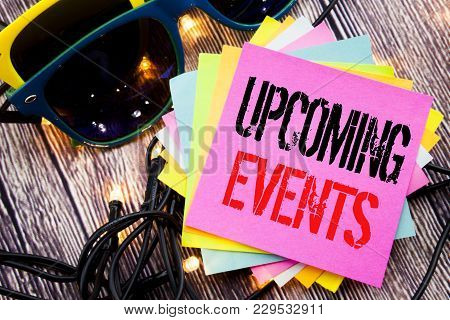 Word, writing Upcoming Events. Business concept for Appointment Agenda List written on old wood wooden background with sunglasses poster