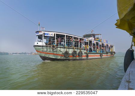 Kolkata, West Bengal , India - January 18th 2015 : A Ferryboat Carrying Passengers Over River Hoogle
