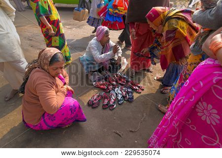 Seller Selling Shoes To Sari Clad Indian Women, Kolkata, India