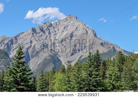 Rocky Mountain And Fur Trees In Banff Alberta Canada