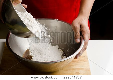 Bakery Cooking, Hand Pouring Flour In A Bowl And Mixing