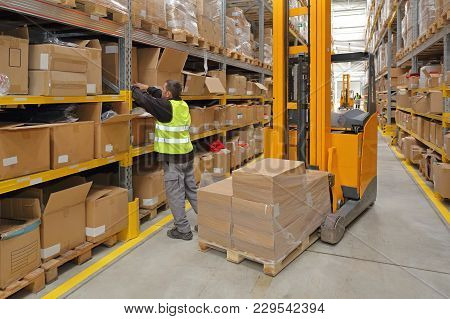 Worker Order Picking Delivery In Fulfillment Warehouse