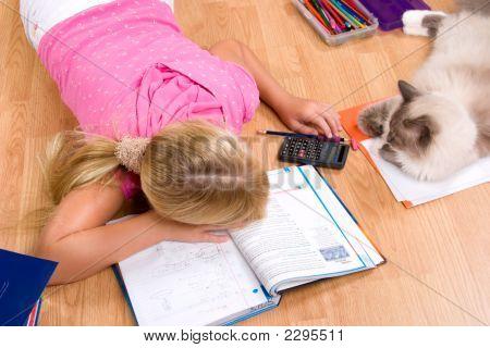 Tired girl taking break while doing her homework poster