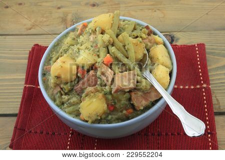 Porcelain Blue Bowl On Red Placemat Over Wooden Table Full With Fresh Slow Cooked Stew Cooked From C