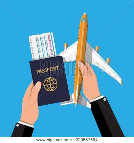 Airplane Top View. Passenger Or Commercial Jet, Boarding Pass And Passport In Hand. Sky With Clouds.