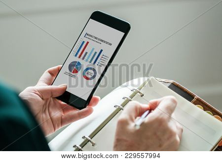 A person taking notes from the presentation