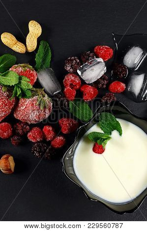 Frozen Raspberry, Strawberries, Yoghurt Plate Mint Leaves,  Pieces Of Ice On Shale Board, Slices Of