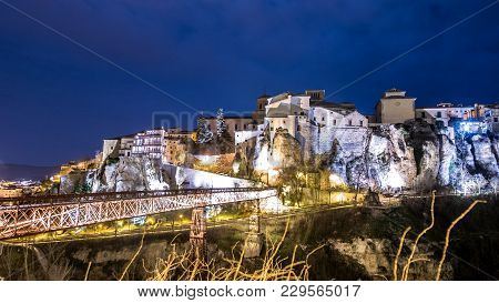 Night View Of Hanging House Over The Rocks With Bridge In Cuenca
