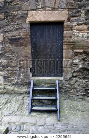 Iron Studded Door And Steps In Alley