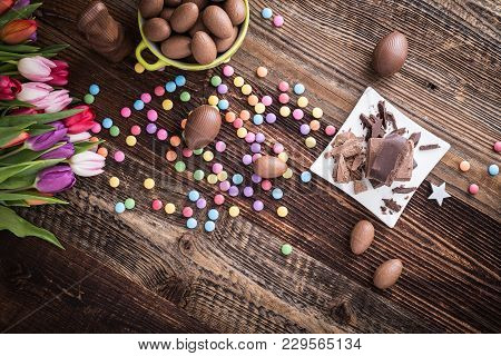 Chocolate Easter Eggs, Dragee And Tulips