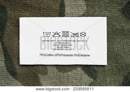 Content And Care Clothes Label On Knitted Khaki Background