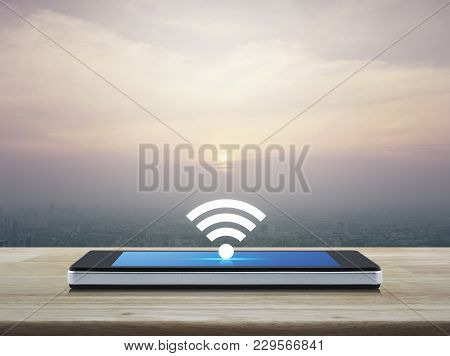 Wi-fi Button Flat Icon On Modern Smart Phone Screen On Wooden Table Over City Tower At Sunset, Vinta