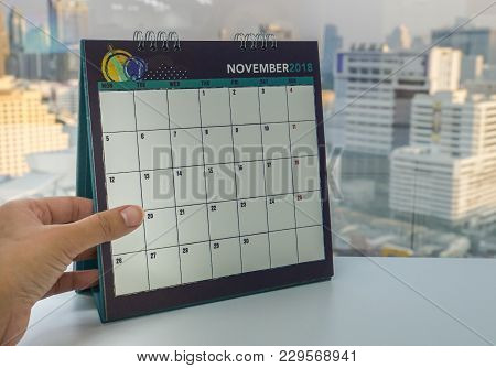 Close Up Businesswoman Left Hand Holds November 2018 Calendar For Appointment Reminder