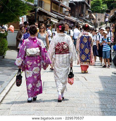 Kyoto, Japan - 16th June 2016: Geisha walking through the historic streets of Kyoto, Japan