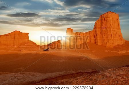 Red Rocks In The Desert Against A Beautiful Sky With Clouds At Dawn. Iran. The Nature Of Persia.