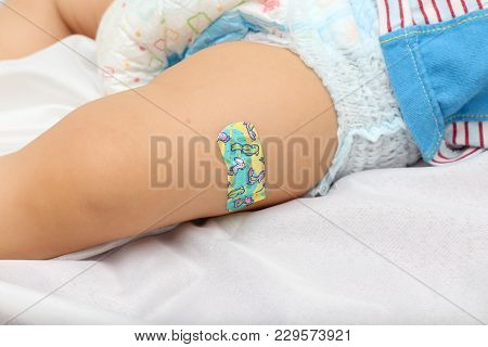 Adhesive Bandage On Asian 9 Months Toddler Baby Boy Child Leg After Vaccination, Little Baby Leg Wit