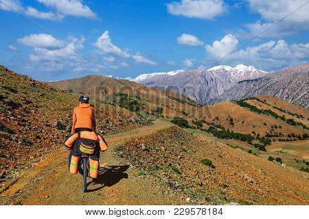 A Man On A Bicycle With A Large Backpack Rides On A Mountain Road Turkey