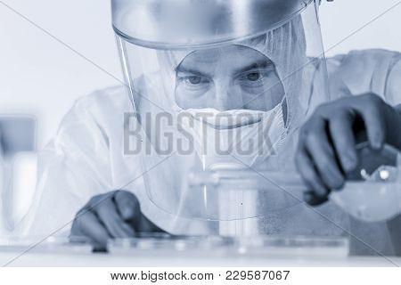 Life Scientist Researching In Bio Hazard Laboratory. Focused Life Science Professional Working On Ex