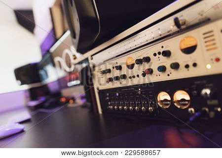 Close Up. Modern Equipment Of The Recording Studio. Equipment Is Installed On The Table. Nearby Is A