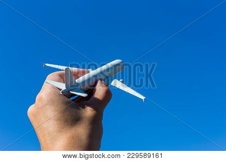 Airplane Model In Hand On Sunny Sky. Concepts Of Travel, Transportation, Transport, Dreaming About H