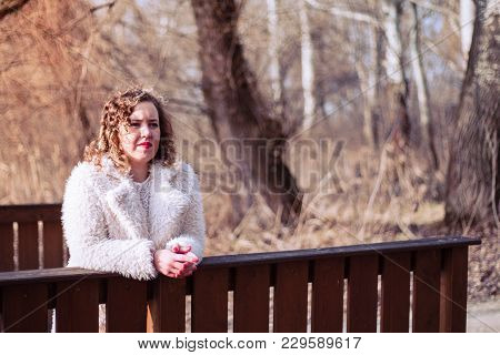 Outdoor Close Up Portrait Of Beautiful Curly Woman Wearing Fur Coat At Park