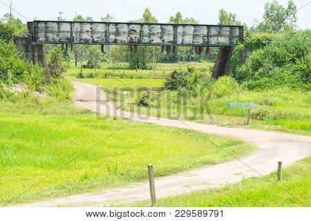 Small Viaduct With Road On Green Grass Field
