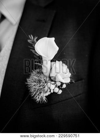 Bridegroom Wearing In Dark Blue Formal Suit With Elegant Boutonniere From Calla Lily Flower In Color
